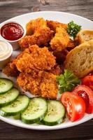 Chicken nuggets and vegetables