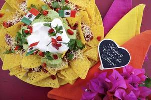 Cinco de Mayo party table with nachos platter.