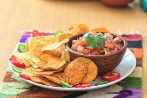 Mexican nachos with homemade scarlet red hot salsa