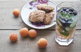 Oat biscuits, apricots and fresh cold lemonade photo