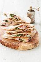 Quesadilla with cheese, meat and vegetables