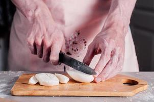 Chopping mozzarella for pizza