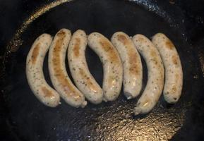 Sausages in frying pan photo