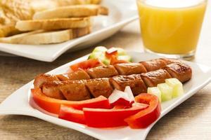 frankfurter breakfast, whit orange juice photo
