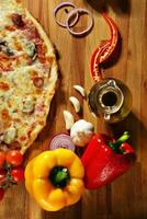 pizza with vegetables herbs and olive oil
