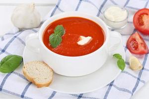Tomato soup with tomatoes in cup
