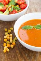 Plate of minestrone soup with cherry tomato photo