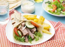 Greek gyros with pork, vegetables and homemade pita bread