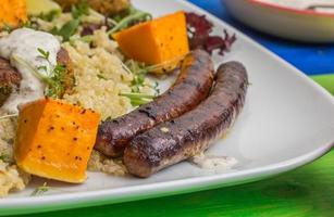 Turkisk sausages with quinoa and roasted pumpkin photo
