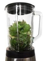 Blender with ingredients for a green smoothie