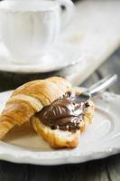 Croissant with chocolate for breakfast.