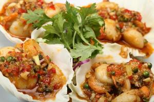 Spicy seafood fried on lettuce leaf