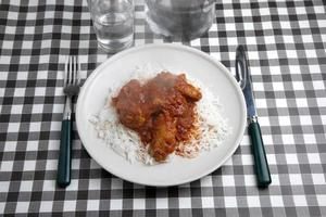 Chicken wings basmati rice in red Thai curry sauce