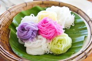 Colorful of Thai vermicelli rice noodles eaten with curry photo