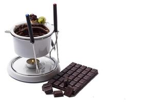 Chocolate fondue on white background