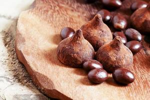 Chocolates truffles and balls on a wooden background photo