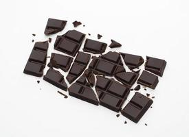 Broken dark chocolate stack isolated on white background