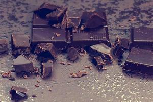 Dark chocolate and coffee bean on a stone table photo