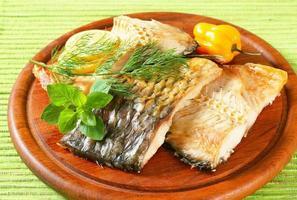 Oven-roasted carp fillets photo