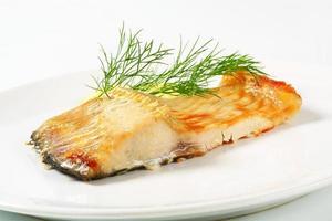 Oven baked carp fillet photo