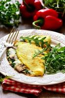 Omelet stuffed with spinach and mushrooms.