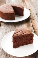 Chocolate cake on white plate.