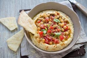Hummus with a salad of tomato, onion and cilantro