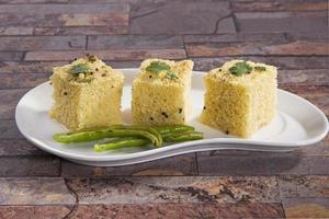 Gujarati Khaman Dhokla or Steamed Gram Flour Snack photo