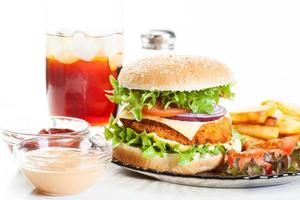 Chickenburger and glass of cola with ice photo