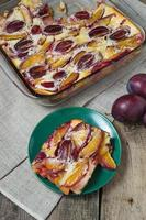 Sweet Plum clafoutis on wooden table