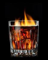 cola with cognac and fire in glass on black photo