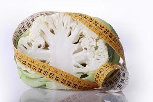 Cauliflower and measuring tape photo