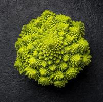 romanesco cabbage on dark background, top view photo
