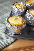 Oranges filled with butter cream. Vertical image. photo