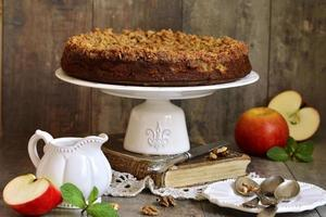 Apple pie with walnut and sugar glaze. photo