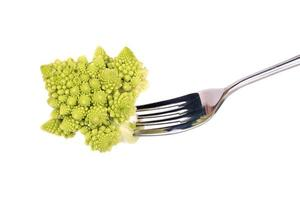 Cabbage romanesco on a fork photo