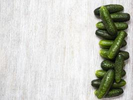 Cucumbers on wooden background photo