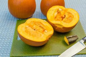 Pumpkins cut in half to extract the seeds photo