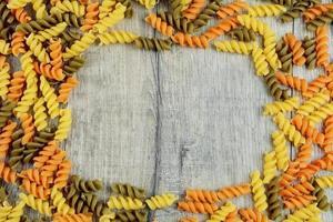 Raw eliche tricolori pasta background
