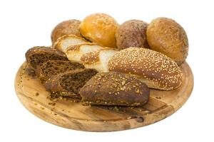 bread, baguettes and buns on wooden platter
