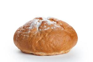 Homemade whole round bread sprinkled with flour photo