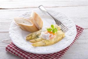Asparagus with sauce photo