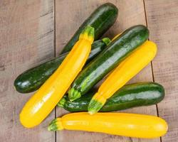 Zucchini and yellow squash on table