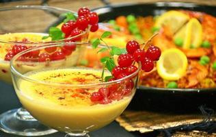 Crema catalana and paella Spanish lunch