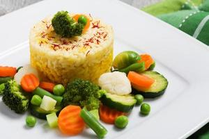 Portion of risotto with vegetables.