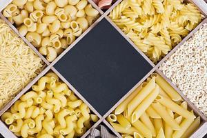 pasta assortment and blackboard for text