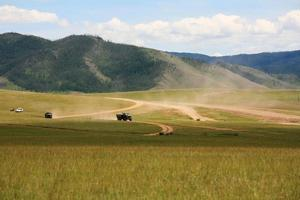 Trucks and nomadic tracks on Central Highlands of Mongolia.