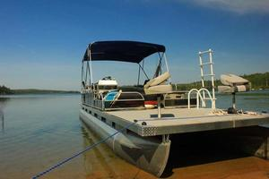 Pontoon on lake photo