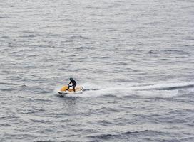 man riding a jet ski photo