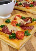 Mini pizza with salami